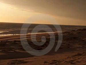 Misty Sunset On The Beach Stock Photo