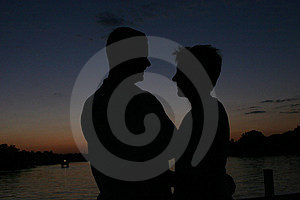 Sillhouette of man and wife at sunset Royalty Free Stock Photography