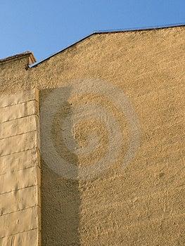 Gul vägg Arkivfoto