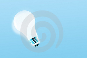 Glowing light bulb Stock Images