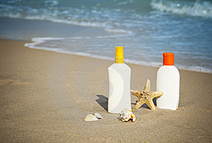 Suntan Lotion Flacons On The Beach With Copy Space Stock Photo - Image: 22017940