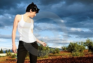 Woman Wearing A White T Shirt In The Field Royalty Free Stock Photo - Image: 22028135