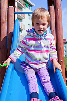 Little Girl Playing On A Playground Slide Stock Images - Image: 22038904