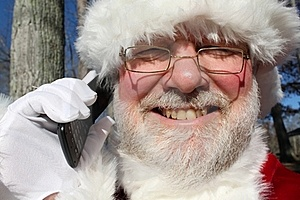 Santa Talking On His Cell Phone Royalty Free Stock Images - Image: 22082749