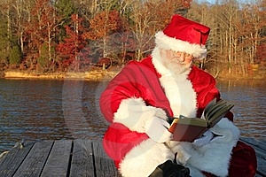 Santa Reading On The Dock Stock Images - Image: 22082944