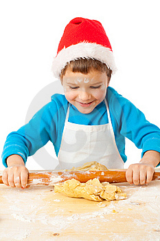 Smiling Little Bot Kneading For Christmas Cooking Stock Image - Image: 22152141