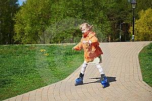 Girl Rides On Roller Skates Royalty Free Stock Photo - Image: 22169385
