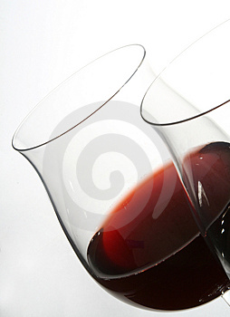 Two wine glasses with red wine Stock Photos