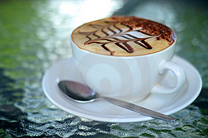 Side View Of Cappuccino Coffee Cup With Spoon Stock Images - Image: 22207594