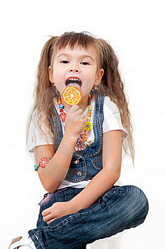 Cute Happy Little Girls Tasting Brigh Lollipop Royalty Free Stock Photography - Image: 22239497