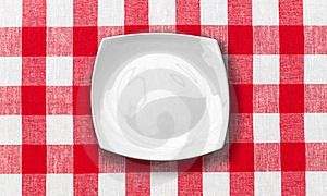 White Plate On Red Checked Fabric Tablecloth Royalty Free Stock Photography - Image: 22269557