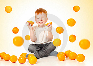 Redheaded Boy With Falling Oranges Royalty Free Stock Image - Image: 22301896