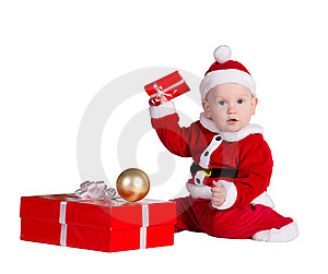 Little Baby Santa With Christmes Prenets Royalty Free Stock Photos - Image: 22306148