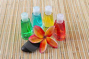 Toiletries And Plumeria Flower On Bamboo Mat With Royalty Free Stock Photos - Image: 22313768