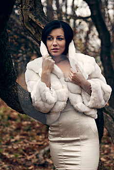 Elegant Girl In White Coat With High Collar Royalty Free Stock Photo - Image: 22316725