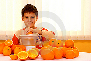 Child With Oranges Royalty Free Stock Photography - Image: 22376597