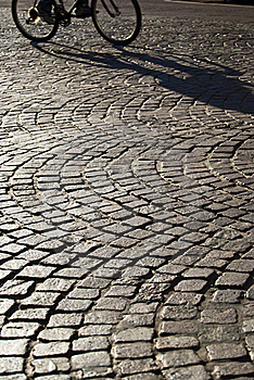 Squared Old Paving With Passing Bicycle Royalty Free Stock Images - Image: 22398419