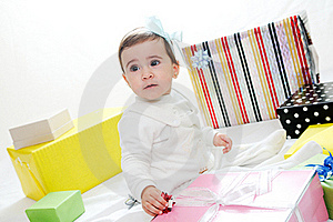 Baby Girl With Gifts. Isolated On White Background Stock Photography - Image: 22402312