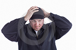 Mean Looking Man Putting On A Beanie Hat Stock Photography - Image: 22419782