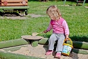 The Girl Playing To A Sandbox Stock Photos - Image: 22449253