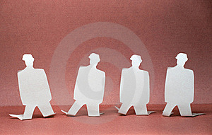 Paper Men On Their Knees Royalty Free Stock Images - Image: 22454629