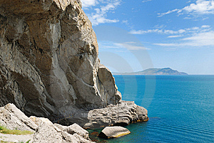 Grotto At The Foot Of The Mountain In The Sea. Royalty Free Stock Photo - Image: 22517555