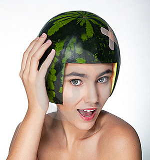 Funny Young Pretty Female In Helmet - Fresh Melon Royalty Free Stock Photography - Image: 22528517