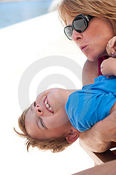 Older Mom Teasing Son With Kisses Stock Images - Image: 22535164