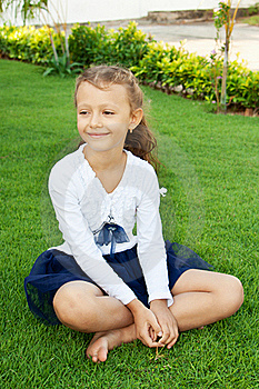 Girl Sitting On The Lawn Stock Photos - Image: 22540513
