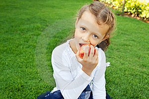 Girl Eating An Apple Stock Image - Image: 22575951