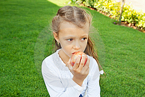 Girl Eating An Apple Royalty Free Stock Photo - Image: 22575965