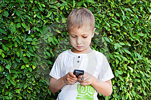Cute Boy With Mobile Phone Stock Images - Image: 22576004