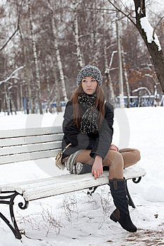 Girl On A Bench In The Winter Royalty Free Stock Image - Image: 22599916