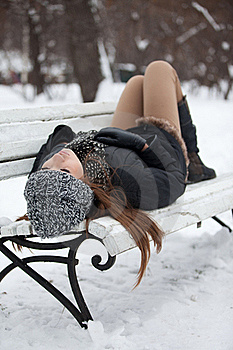 Girl On A Bench In The Winter Stock Photos - Image: 22599923