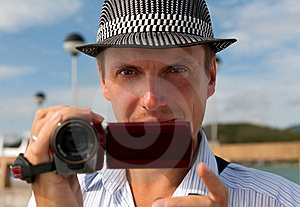 Man In A Hat With A Camera Royalty Free Stock Photo - Image: 22601395