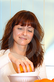 Woman Making Orange Juice Royalty Free Stock Photography - Image: 22615107