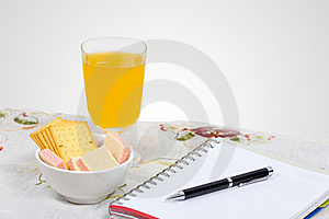 Wafer, Cheese Crackers And Empty Note Book. Royalty Free Stock Photos - Image: 22680848