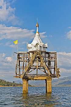 Part Of Thai Church Bell Tower Expose In The River Stock Image - Image: 22693331