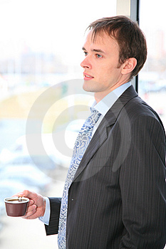 Businessman with coffee Stock Image