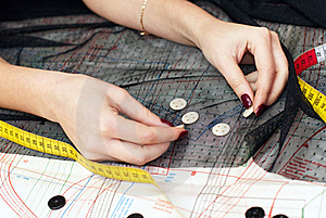 Female Hands Choosing Buttons Stock Photos - Image: 22867613