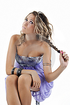Girl Sitting With Funny Expression, Pulling Hair. Royalty Free Stock Photo - Image: 22886195