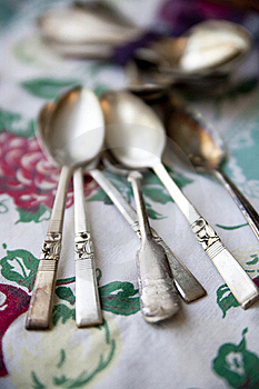 Vintage Silver Spoons On An Antique Tablecloth Royalty Free Stock Image - Image: 22890396