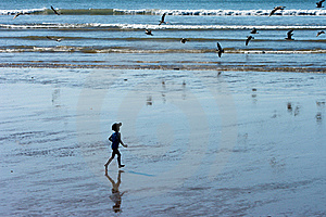 A Boy Running On The Ocean Beach Stock Images - Image: 22891954