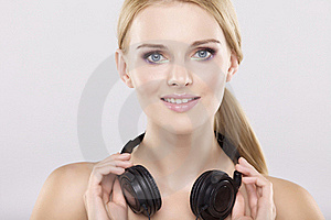 Beautiful Girl Is Listen To The Music Stock Photography - Image: 22971762