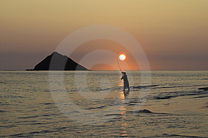Fisherman At Sunrise Stock Image - Image: 22995531