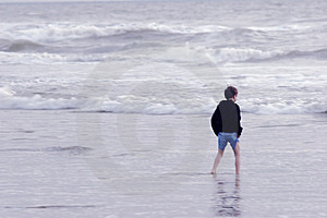 Boy Walking In The Sea Free Stock Image