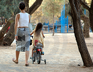 Little Girl On Tricycle Stock Photos