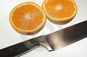 Sliced Orange With Knife Free Stock Photo