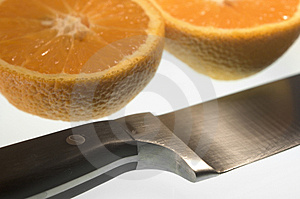 Closeup Of Sliced Orange And Knife Free Stock Images