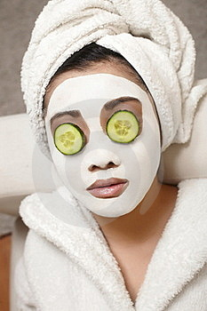 Chinese Woman With Cucumbers And Mask Stock Photo - Image: 23006040